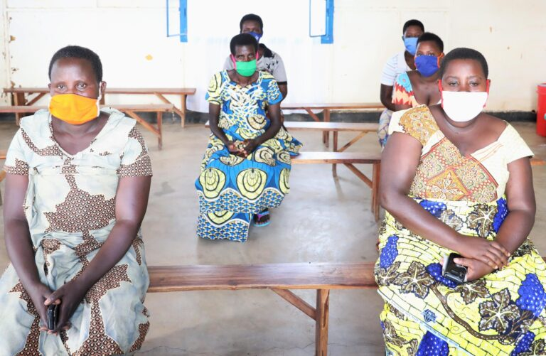 savings and credit groups run by Caritas Rwanda in Mahama camp